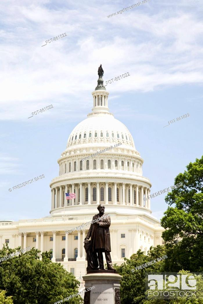 Stock Photo: Bronze statue in front of the United States Capitol Building, Washington DC, USA.