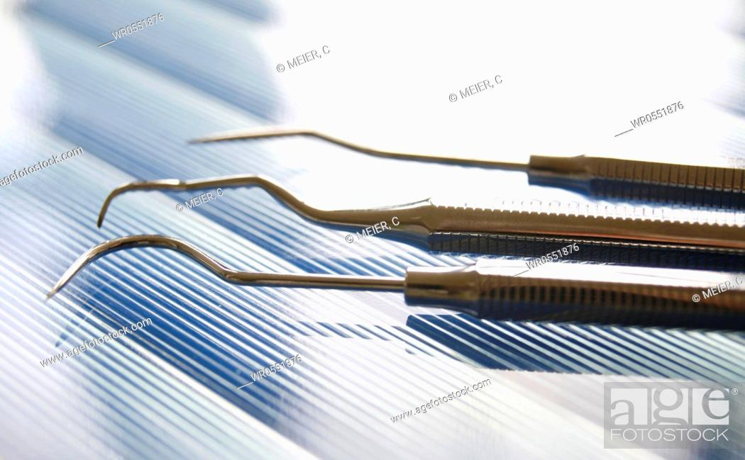Stock Photo: Dental set of instruments : Three dental explorer - Tooth probe.