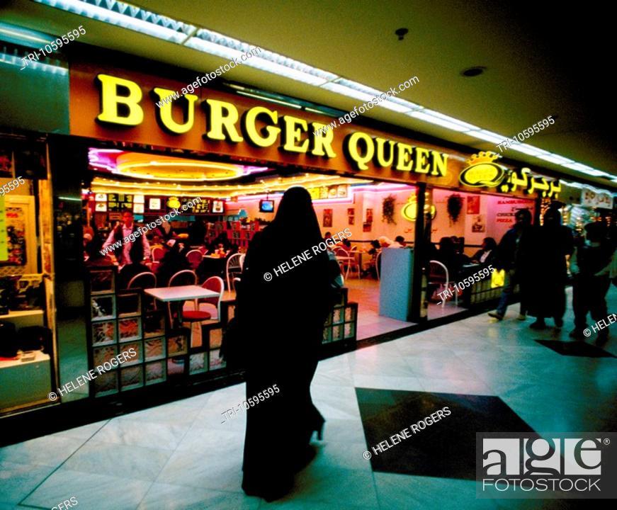 Stock Photo: Kuwait City Kuwait Burger Queen Woman In Burka Al Muthanna Shopping Centre,.