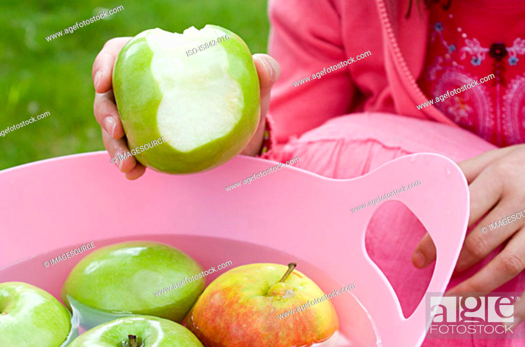 Stock Photo: Girl with apples.