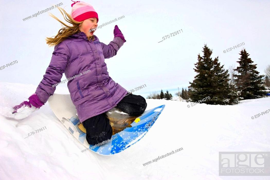 Stock Photo: Young Girl Tobogganing.