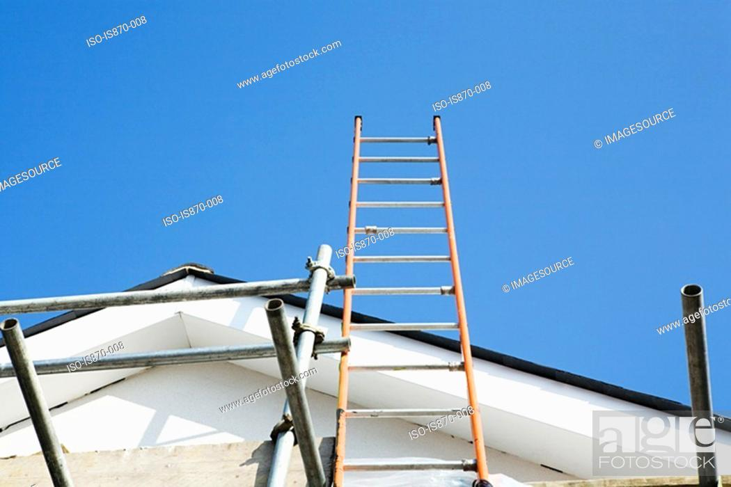 Stock Photo: Ladder and scaffold on side of house.