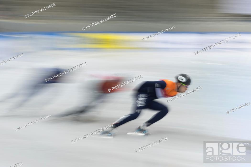Stock Photo: 01 February 2019, Saxony, Dresden: Shorttrack: World Cup, preliminary, 1000 meters men in the EnergieVerbund Arena. Dylan Hoogerwerf (r) from the Netherlands.