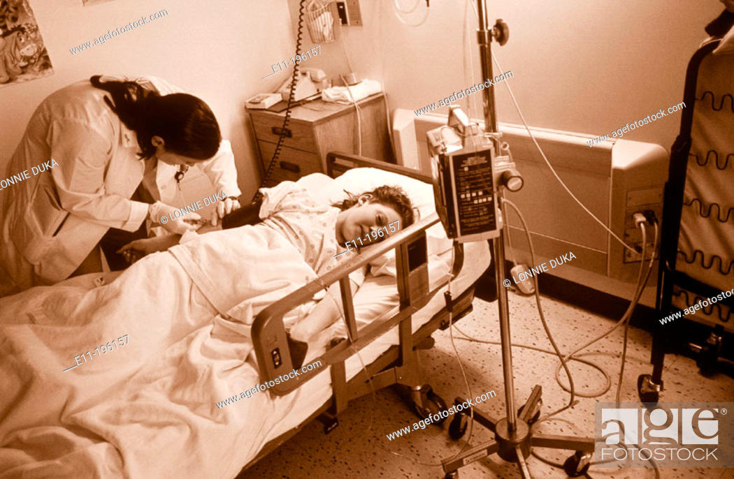 Stock Photo: Teen girl in hospital bed.