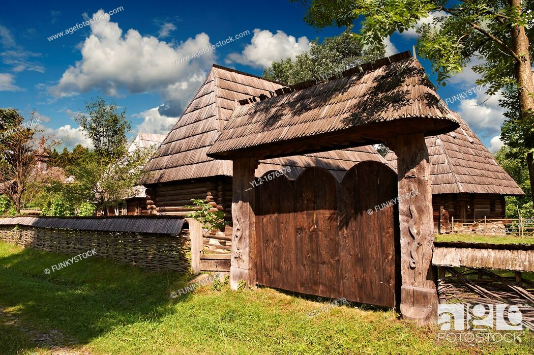 Stock Photo: 19th century traditional farm house & gate of the Iza Valley, The Village museum near Sighlet, Maramures, Northern Transylvania.