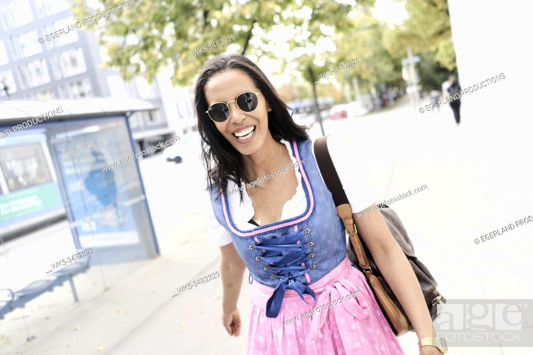 Stock Photo: Brazilian woman wearing Dirndl, Munich, Germany.