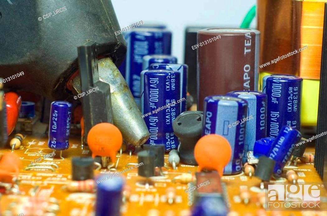 Stock Photo: Glue gun on a chipset.