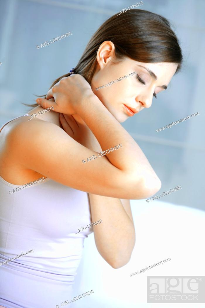 Stock Photo: young brunette woman with neck pain.