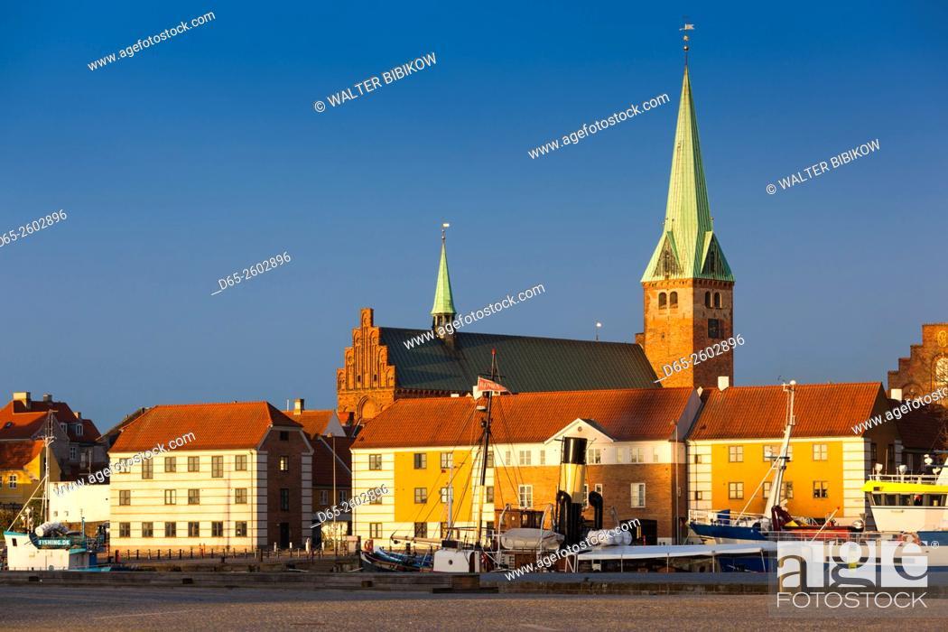 Stock Photo: Denmark, Zealand, Helsingor, town view and Sankt Olai Domkirke Church, dawn.