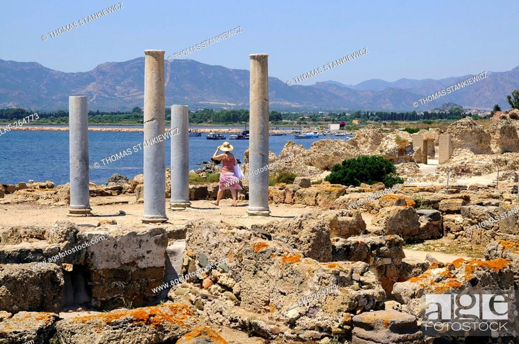 Stock Photo: A woman at the excavations of the antique town Nora, South Sardinia, Italy, Europe.