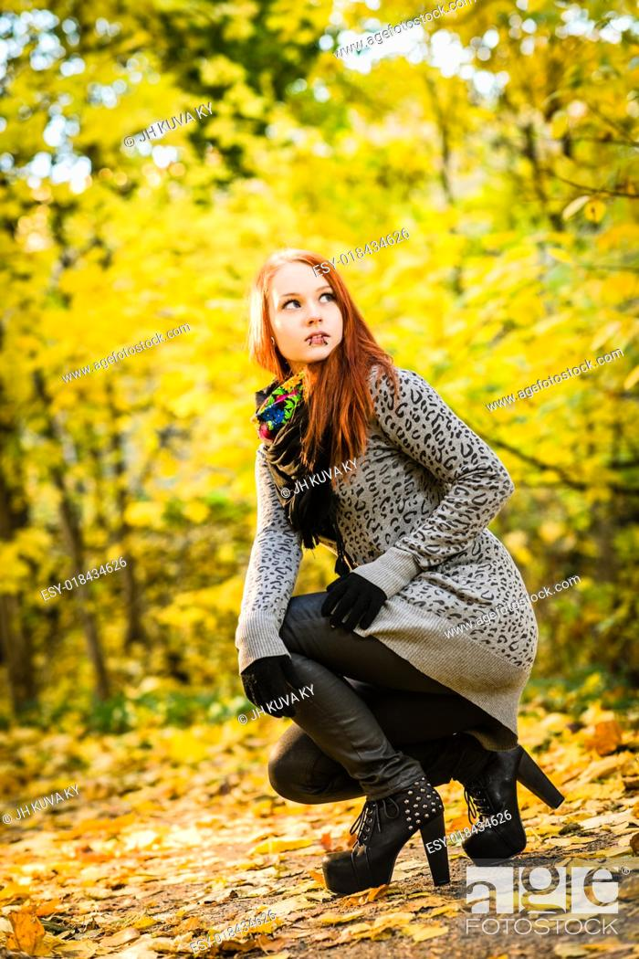 Imagen: Girl with a high heels on the park, colors of autumn.
