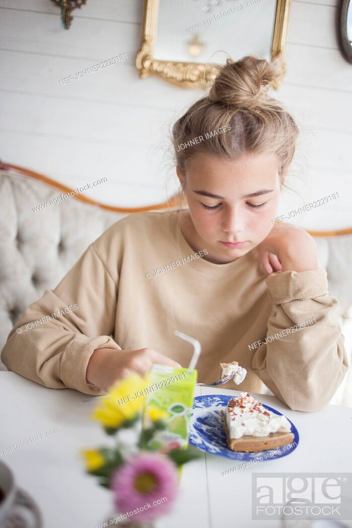 Stock Photo: Girl having cake.