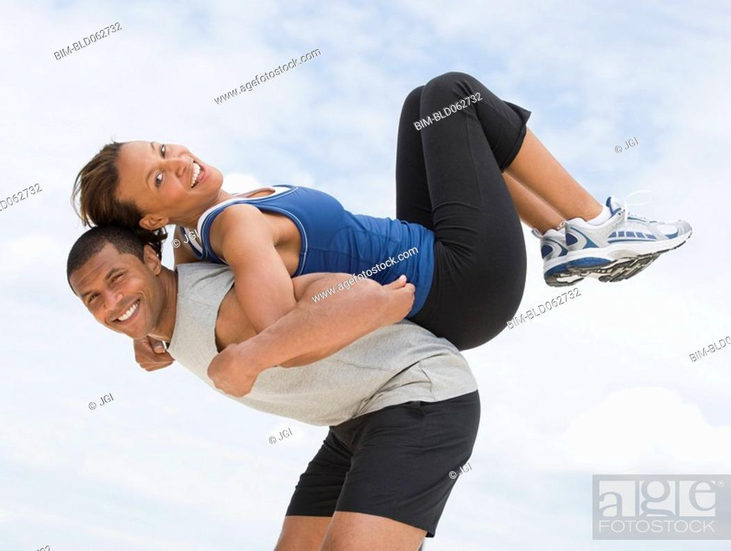 Stock Photo: African couple in athletic clothing.