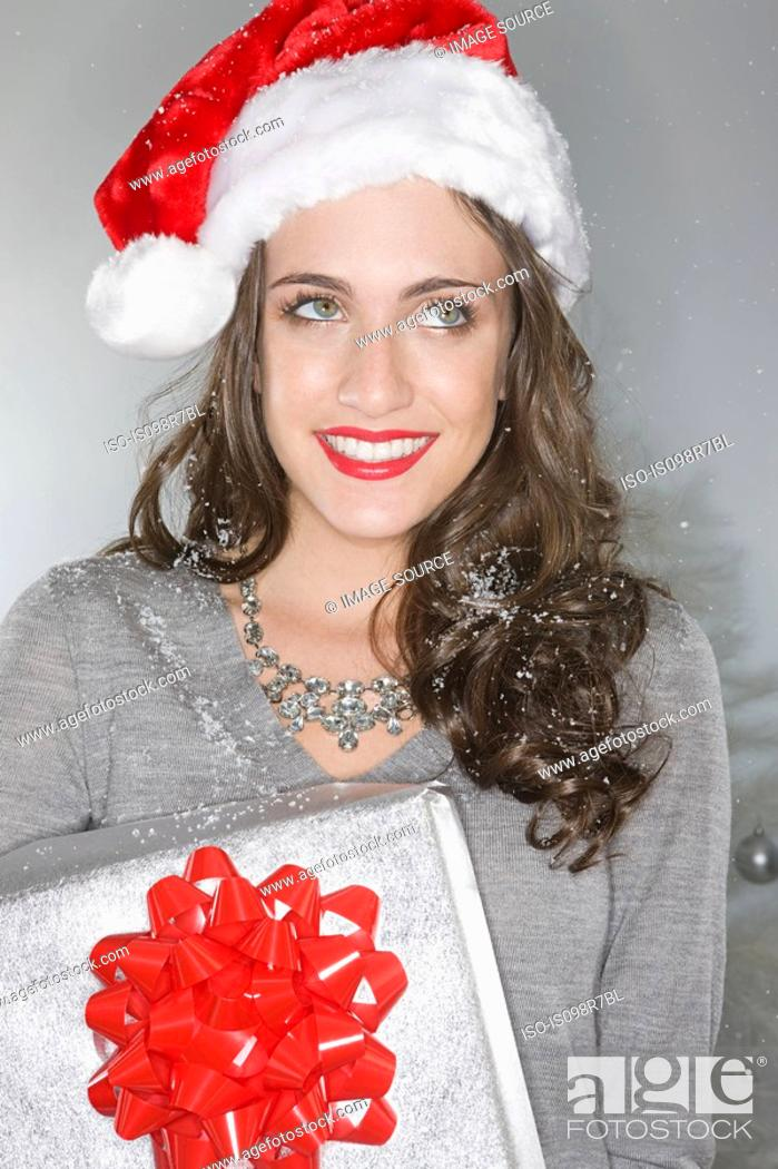 Stock Photo: Young woman wearing a santa hat.