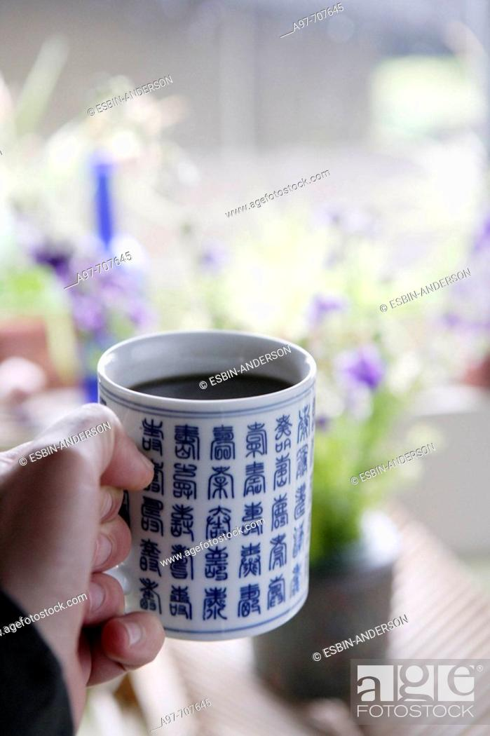 Stock Photo: Close-up of hand holding asian style coffee cup.