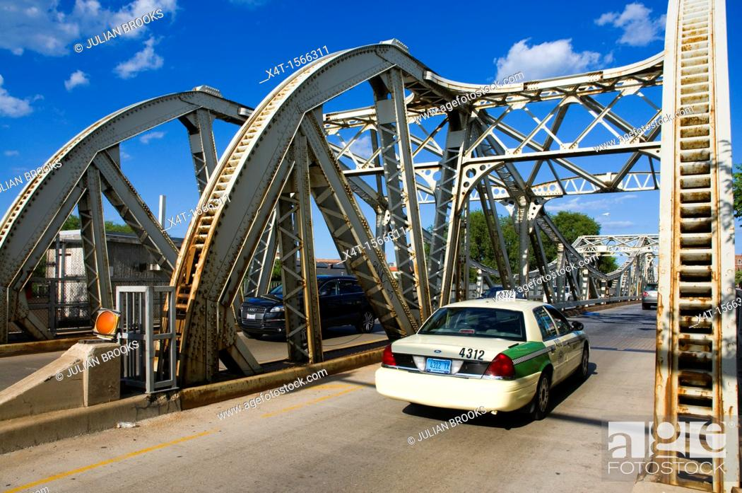 Stock Photo: A taxi cab crossing a bridge in Chicago on West Division Street.