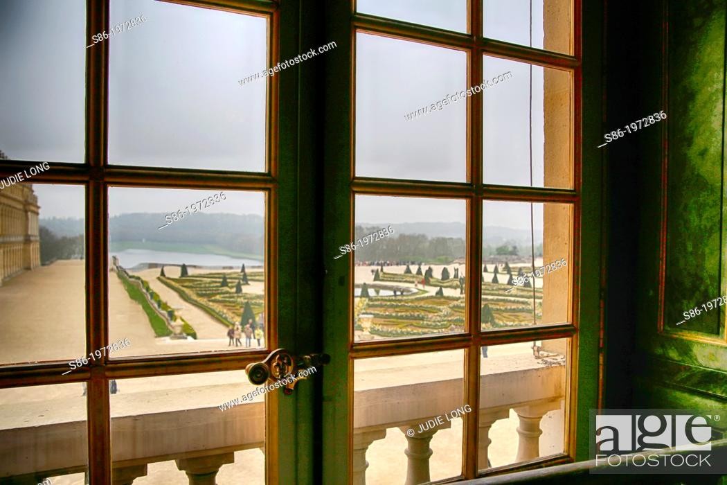 Stock Photo: View of the Gardens from a Second Floor Window, Chateau Versailles.