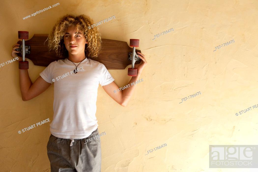 Stock Photo: Teenage boy with his longboard.