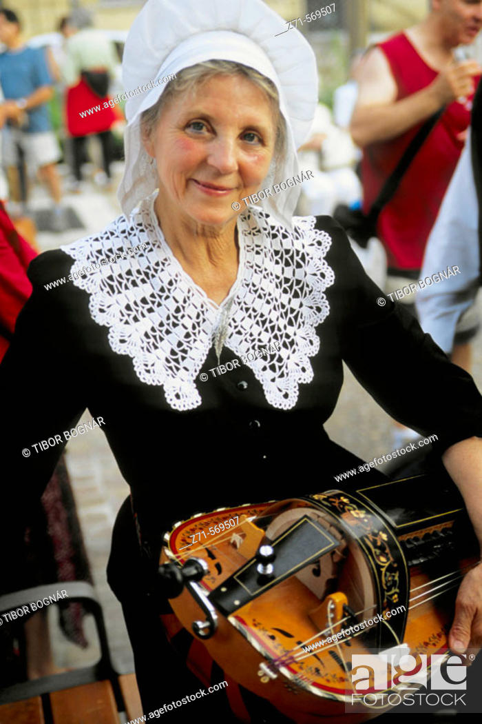 Stock Photo: France, Périgord, Sarlat, Bastille Day, lady with traditional musical instrument.