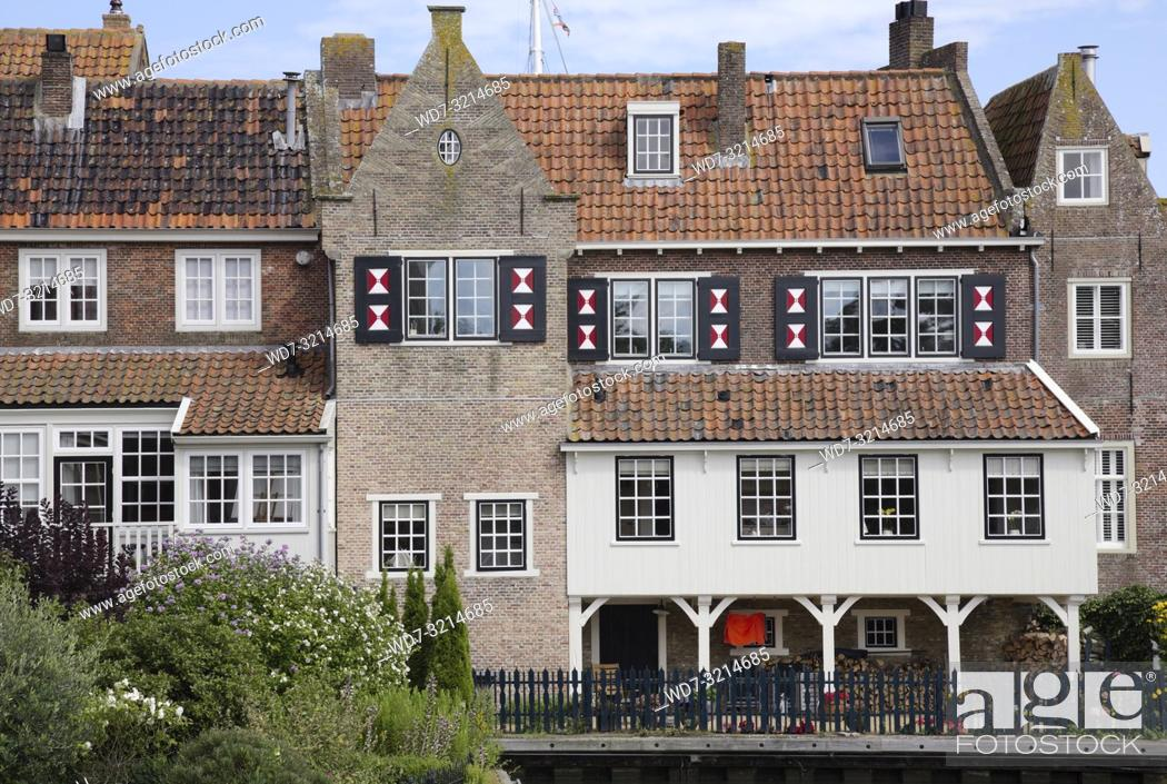 Stock Photo: Enkhuizen, small city of northern holland, historic buildings with many windows and flowers.