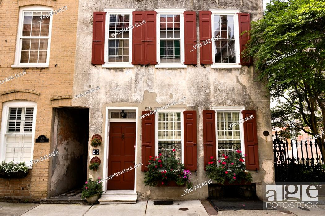 Stock Photo: Flowers blooming in window boxes with traditional shutters along Queen Street in historic Charleston, SC.