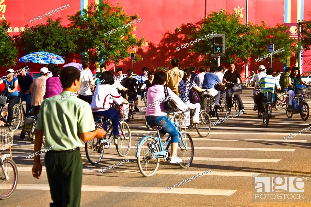 Stock Photo: Group of people riding bicycles, HohHot, Inner Mongolia, China.