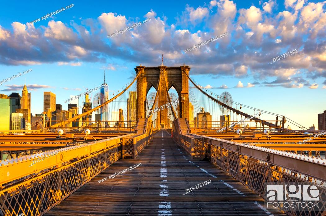 Stock Photo: The Brooklyn Bridge is one of the oldest suspension bridges in the United States. Completed in 1883, it connects the New York City boroughs of Manhattan and.