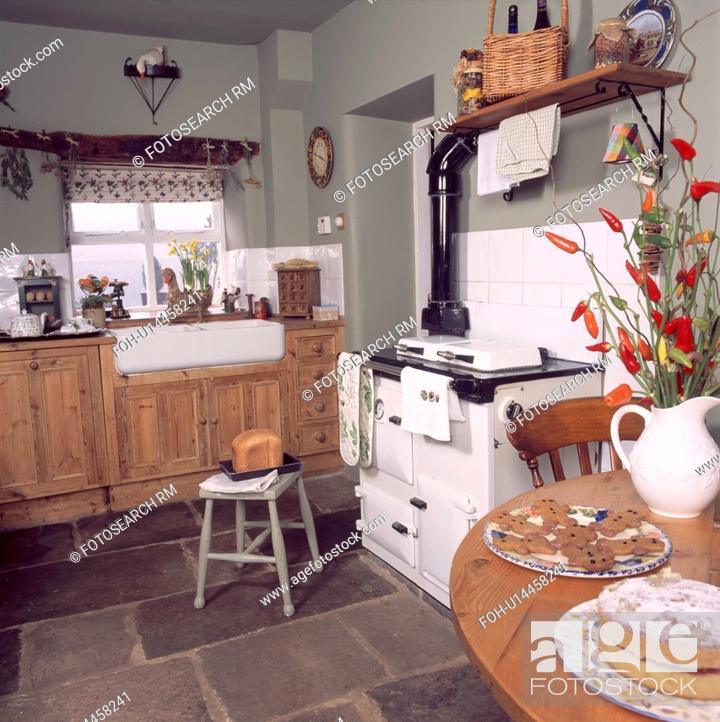 Pine Table And White Aga Oven In Grey Country Kitchen With Fitted