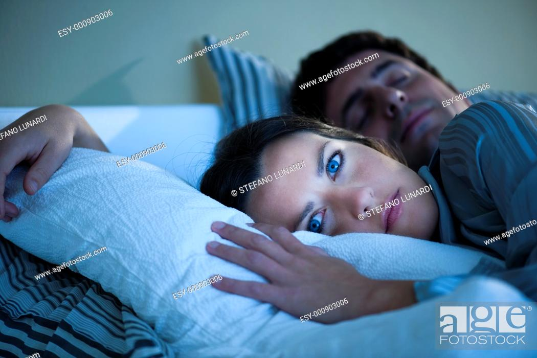 Stock Photo: Young woman cannot sleep.