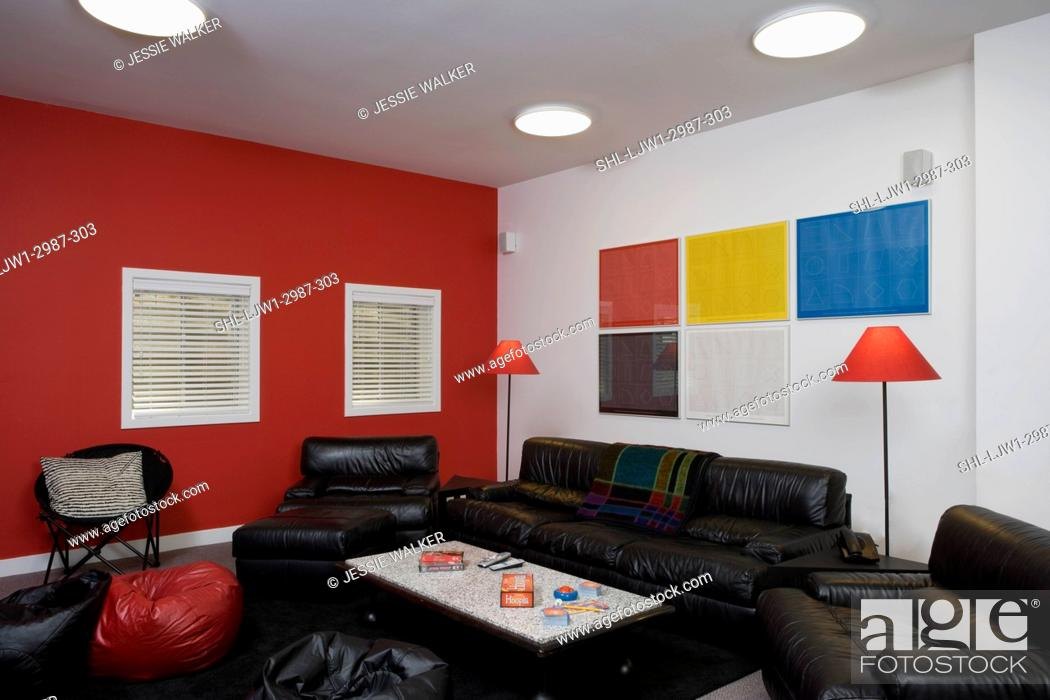 Stock Photo Bats Media Viewing Area Black Leather Sofas And Chairs Red Wall Colorful Print Art Shaded Lamps