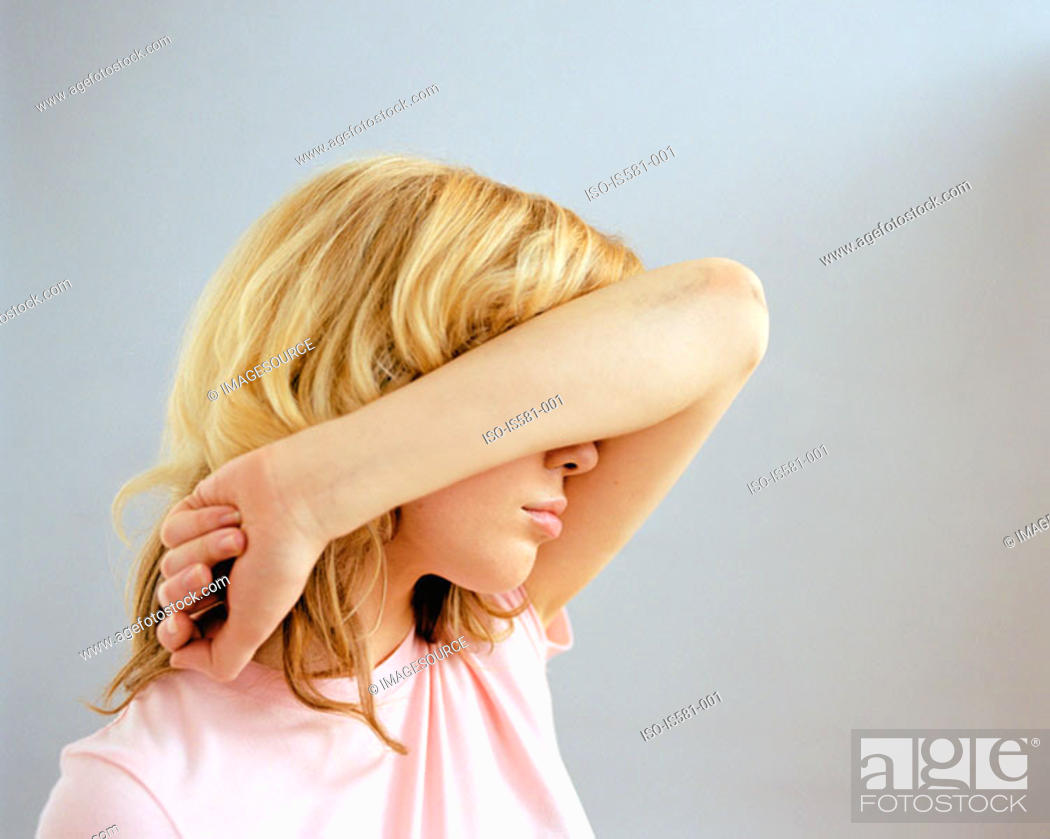 Stock Photo: Woman covering face with arm.