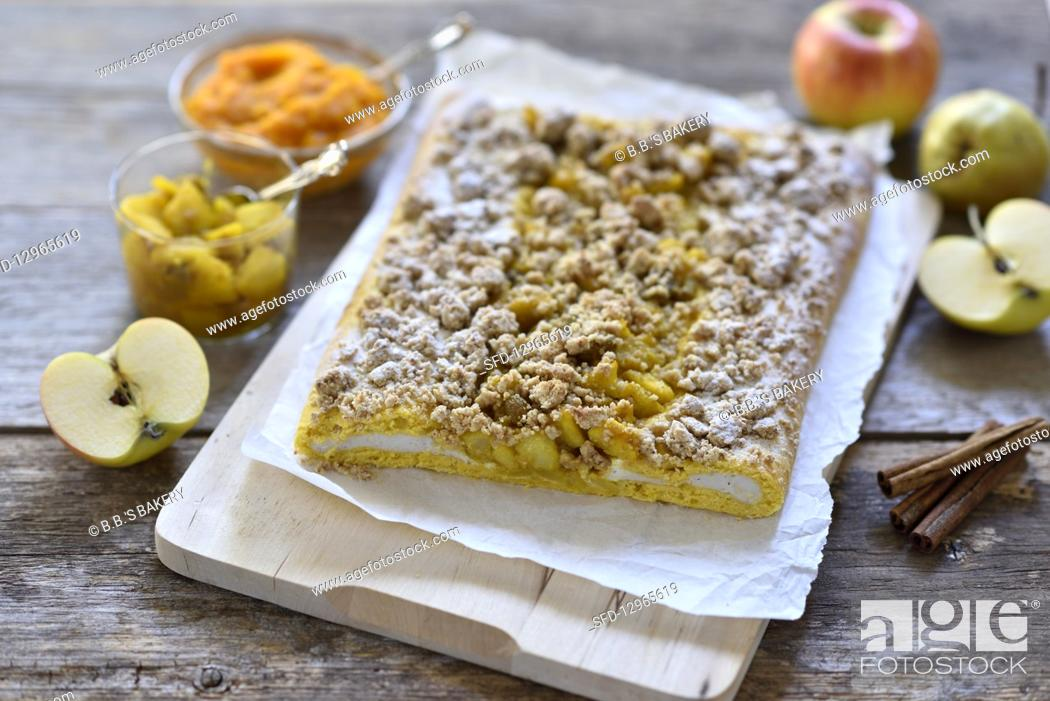 Photo de stock: Vegan pumpkin and quark yeast dough strudel with apple and pear compote and oat and date crumbles on a wooden board.