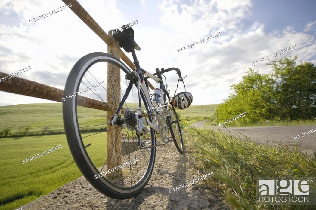 Stock Photo: Racer bike parked on roadside by the railing.