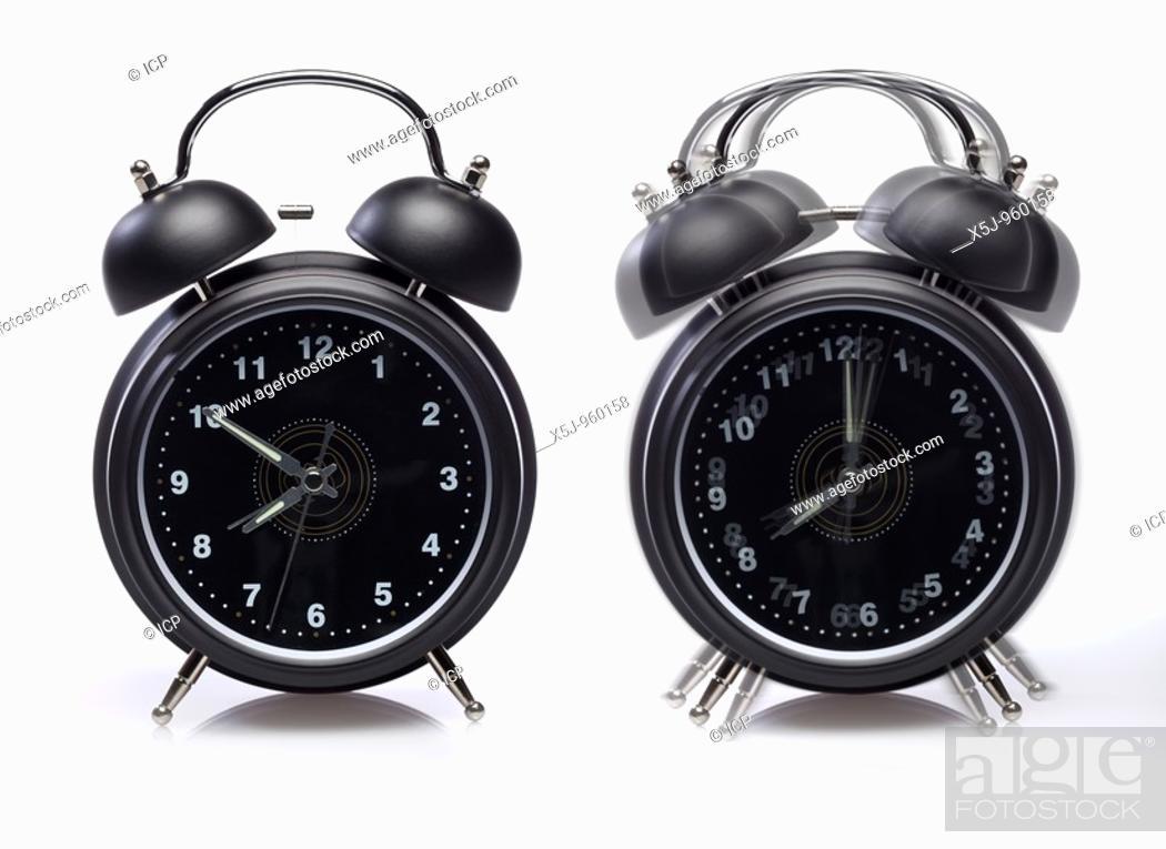 Stock Photo: Two alarm clocks one still ringing - on white background.