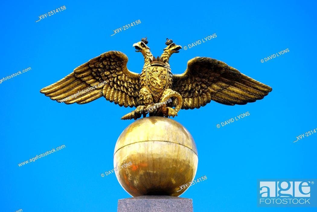 Stock Photo: Helsinki, Finland. The Stone of the Empress Alexandra Feodorovna in Market Square. Two headed eagle on an orb Romanov symbol.