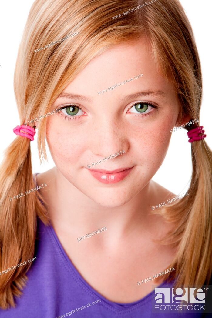 Stock Photo: Beautiful cute sincere face of happy teenager girl with pigtails, blond hair, green eyes and freckles, isolated.