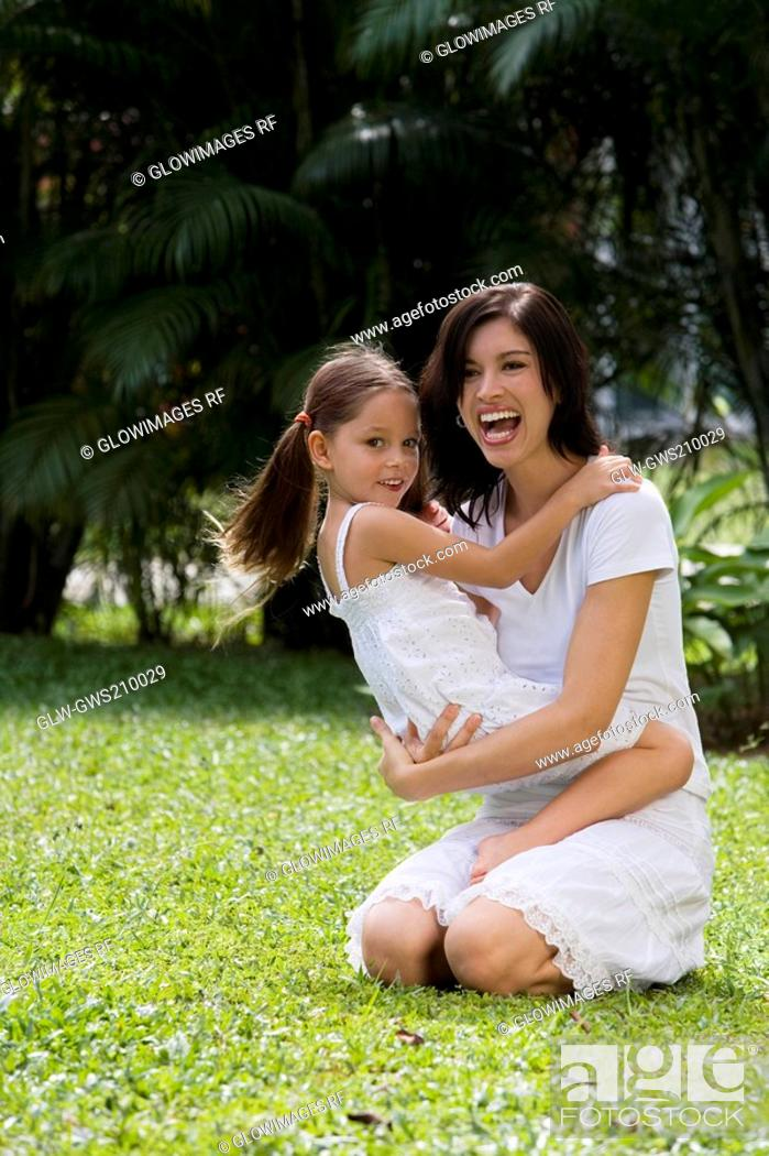 Stock Photo: Young woman playing with her daughter.