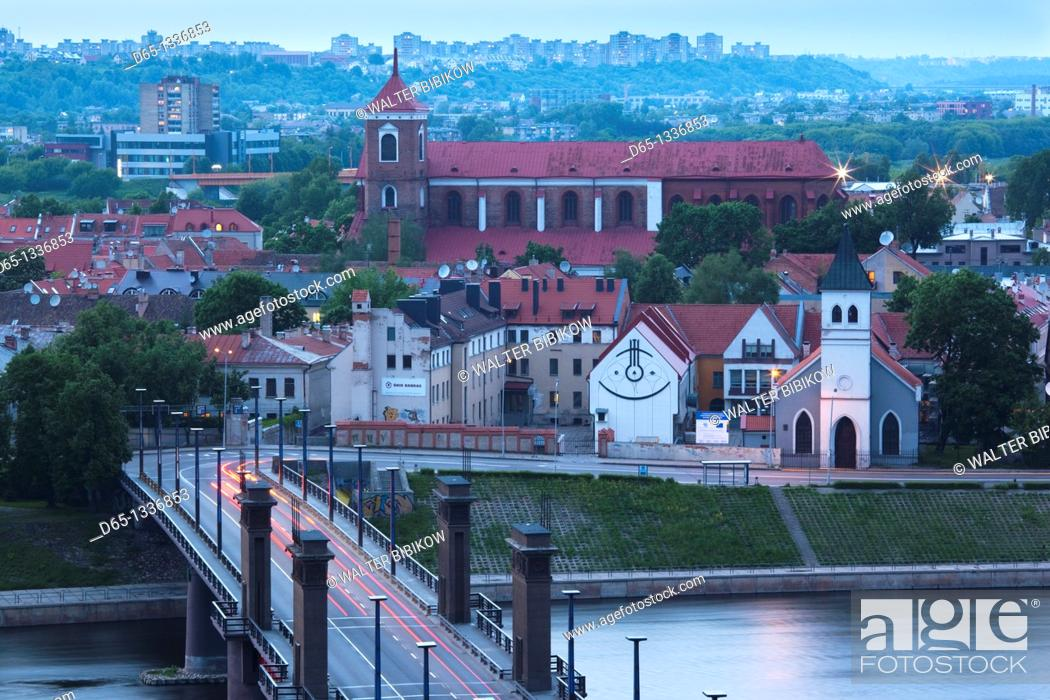 Stock Photo: Lithuania, Central Lithuania, Kaunas, elevated view of Sts  Peter and Paul Cathedral and Aleksoto tiltas bridge, dusk.