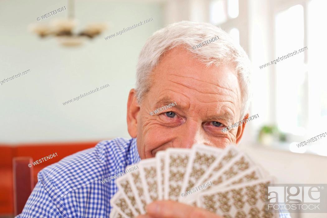 Stock Photo: Germany, Leipzig, Senior man playing cards.