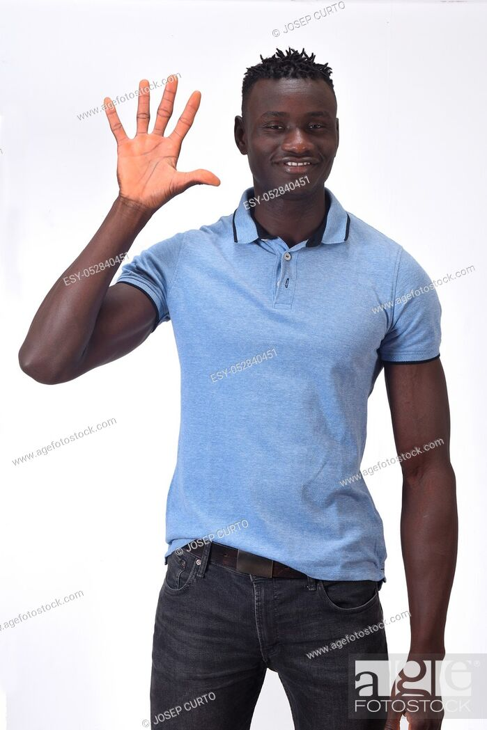 Stock Photo: african man with finger in the shape of number five.