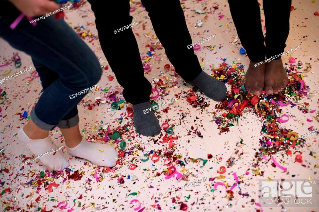 Stock Photo: confetti party Multiethnics happy young people group celebrating new year eve while dancing and have fun at home.