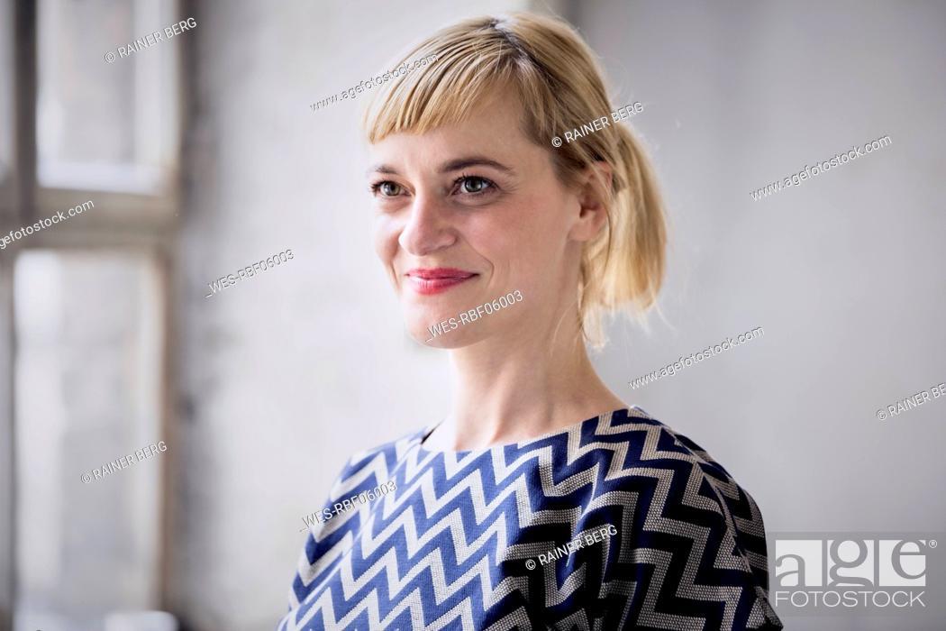 Stock Photo: Portrait of happy blond businesswoman.