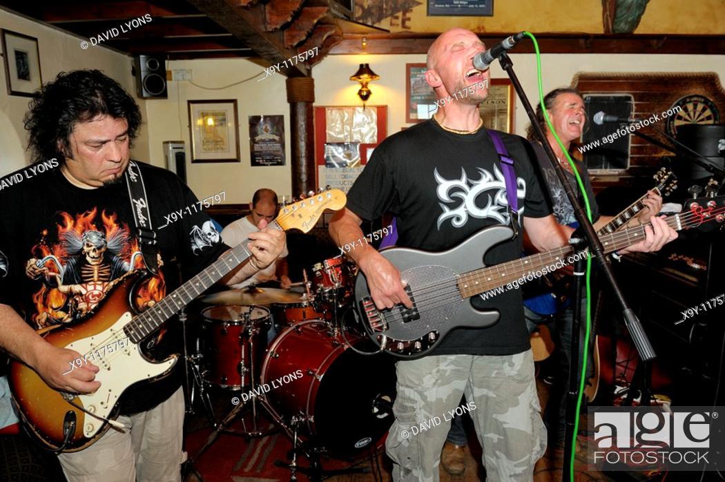 Stock Photo: Karac, rock blues 4 piece band performing in the Sailors Return pub during Maryport Blues Festival, 2010  Cumbria, England.