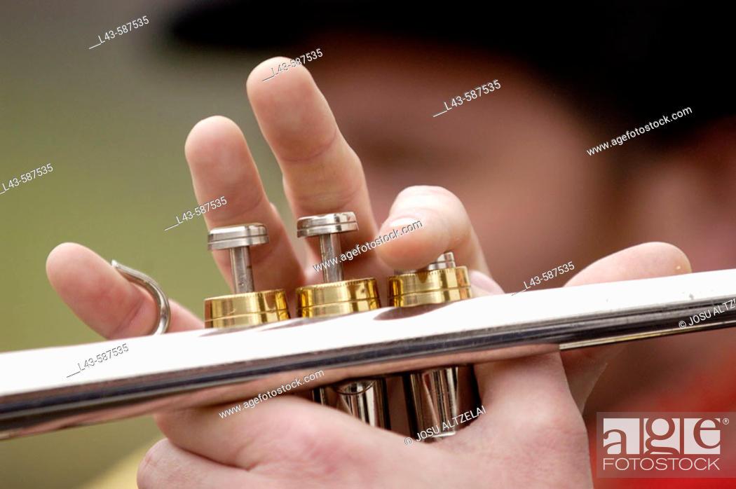 Stock Photo: Playing trumpet.