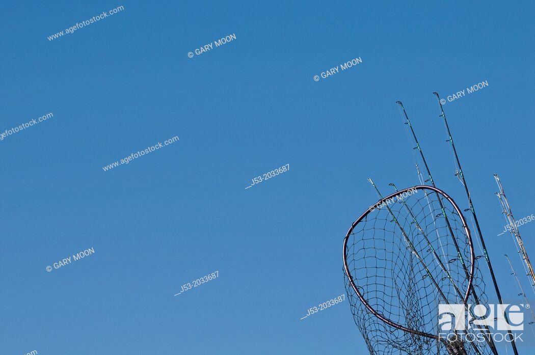 Stock Photo: Fishing poles and net on charter fishing boat, Oregon.