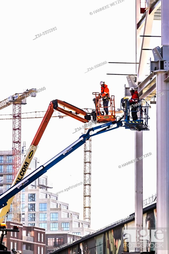Stock Photo: Men working at a construction site at Strijp-S, Eindhoven, The Netherlands, Europe.
