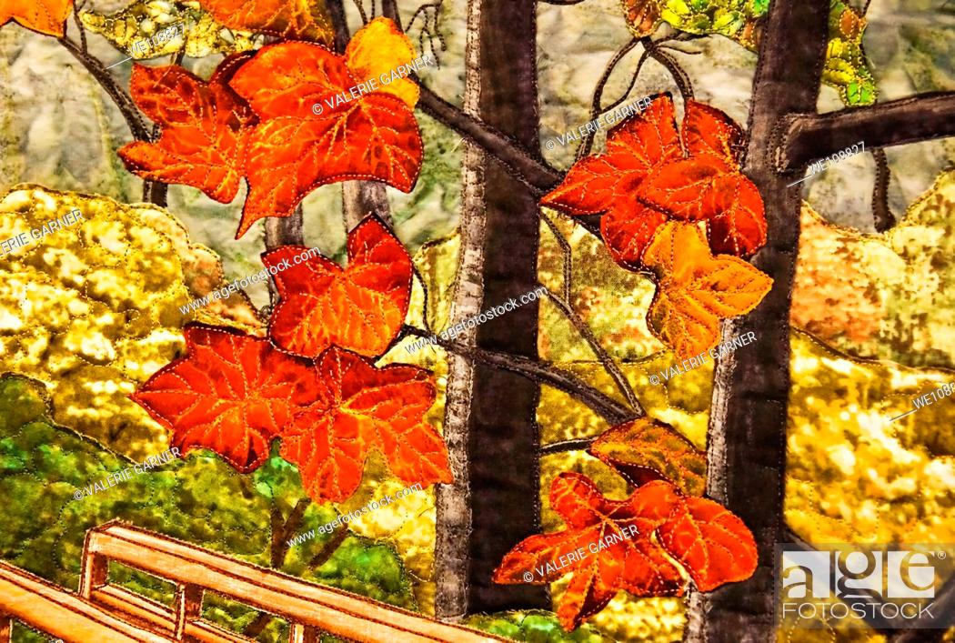 Stock Photo: This abstract features gorgeous autumn leaves scenic quilted on fabric for an unusual fall foliage shot.
