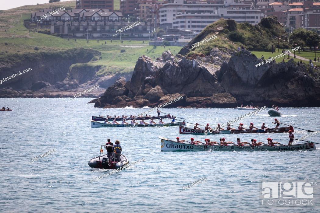 Stock Photo: CASTRO URDIALES, SPAIN - JULY 15, 2018: Competition of boats, regata of trainera, Ondarroa Cikautxo, Cabo, Donostiarra and Santurtzi Iberdrola boats in action.