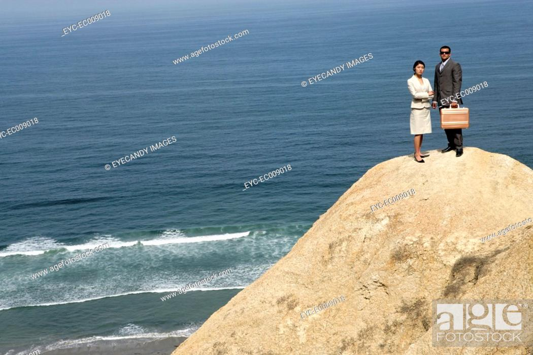 Stock Photo: View of a man and a woman standing on a cliff.