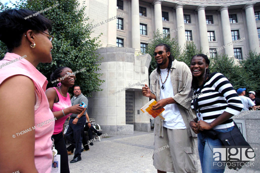 "Stock Photo: Etan Thomas of the Washington Wizards signs some autographs and talks with fans during the DC hip hop Theatre Festival, during the Fest's ""Poetry Slam""."